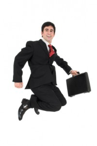 Young businessman jumping in the air